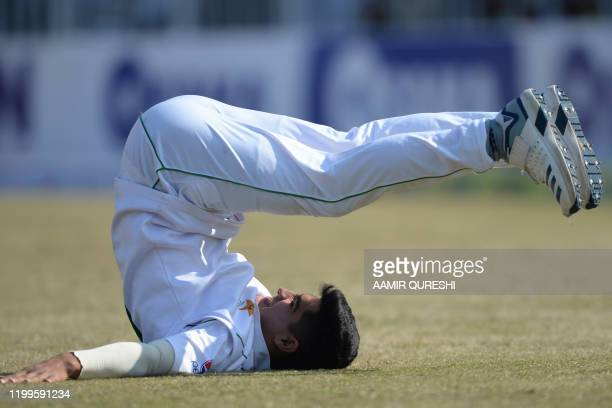 Pakistan's bowler Naseem Shah stretches before bowling during the third day of the first cricket Test match between Pakistan and Bangladesh at the...