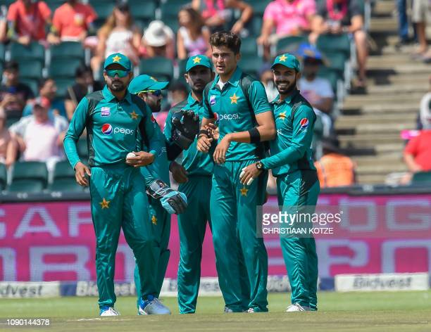 Pakistans bowler Shaheen Shah Afridi celebrates after getting the wicket of South Africas Wicketkeeper Quinton de Kock during the 4th ODI cricket...