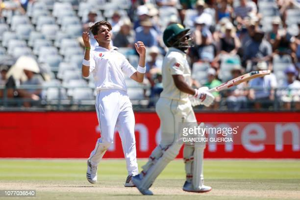 Pakistan's bowler Shaheen Shah Afridi reacts after bowling on South African batsman Temba Bavuma during the second day of the second Cricket Test...