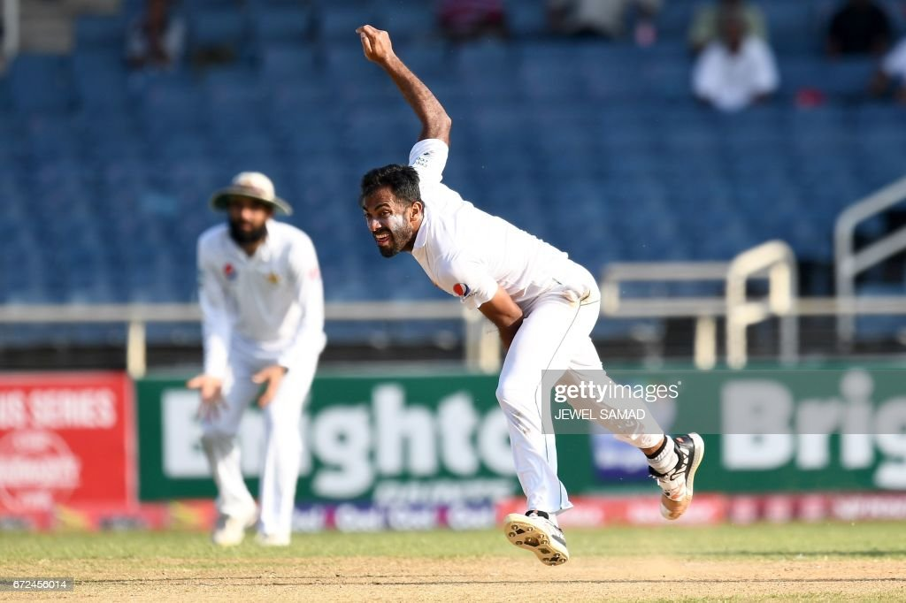 Pakistan's bowler Wahab Riaz delivers a ball on day four of the first Test match between West Indies and Pakistan at the Sabina Park in Kingston, Jamaica, on April 24, 2017. / AFP PHOTO / Jewel SAMAD