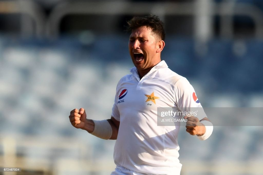 Pakistan's bowler Yasir Shah celebrates after dismissing West Indies' batsman Shai Hope on day four of the first Test match between West Indies and Pakistan at the Sabina Park in Kingston, Jamaica, on April 24, 2017. / AFP PHOTO / Jewel SAMAD