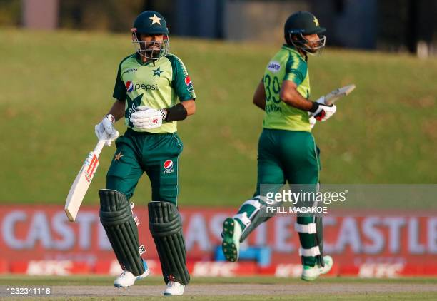 Pakistan's captain Babar Azam and teammate Fakhar Zaman run between the wickets during the fourth Twenty20 international cricket match between South...
