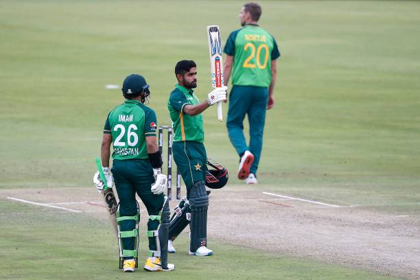 Pakistan's captain Babar Azam celebrates after scoring a century during the first one-day international cricket match between South Africa and...