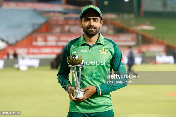 Pakistan's captain Babar Azam holds the trophy after Pakistan won the series, after the third one-day international cricket match between South...