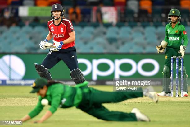 Pakistan's captain Bismah Maroof dives to stop a ball played by England's Natalie Sciver during the Twenty20 women's World Cup cricket match between...