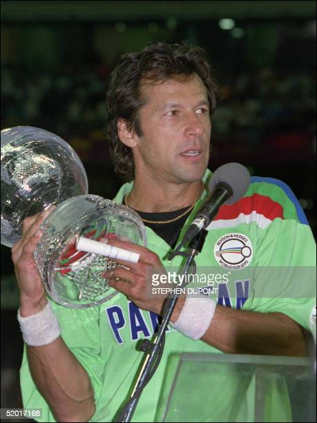Pakistan's captain Imran Khan holds the 1992 World Cup Trophy during the victory presentation at the Melbourne Cricket Ground 25 March 1992 Pakistan...