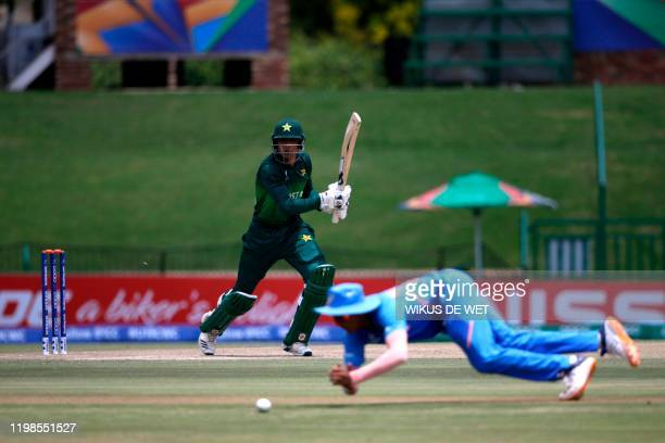 Pakistan's captain Rohail Nazir watches the ball after playing a shot as India's Yashasvi Jaiswal misses the ball during the Semi-Final of the ICC...