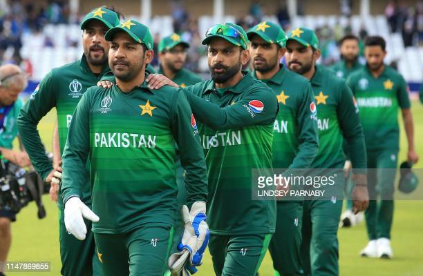 Pakistan's captain Sarfaraz Ahmed leads his team off of the pitch after winning the 2019 Cricket World Cup group stage match between England and...