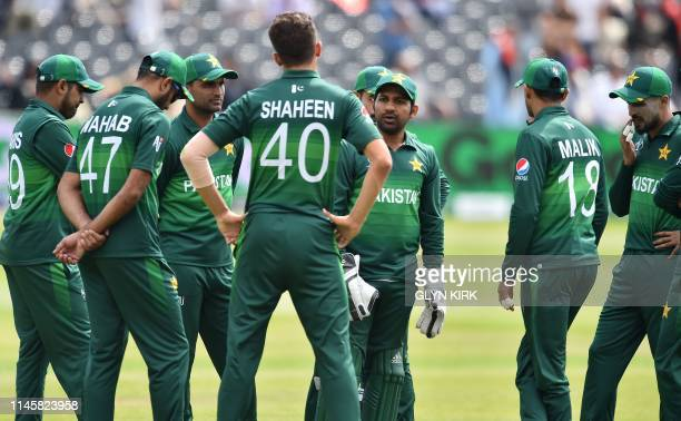 Pakistan's captain Sarfaraz Ahmed talks with Pakistan's bowler Shaheen Shah Afridi during a break in play at the 2019 Cricket World Cup warm up match...