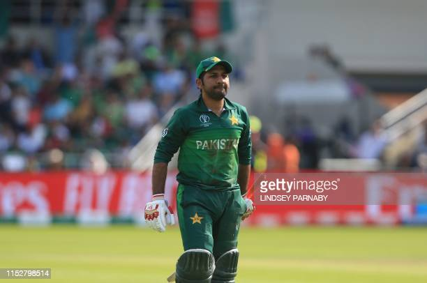 Pakistan's captain Sarfaraz Ahmed walks back to the pavilion after his dismissal during the 2019 Cricket World Cup group stage match between Pakistan...