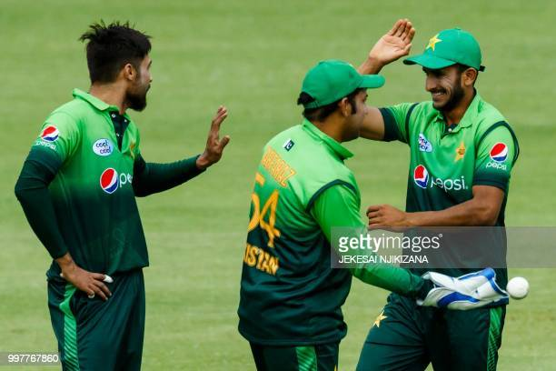 Pakistan's captain Sarfraz Ahmed celebrates victory with his players after the first one day international cricket match between Pakistan and...