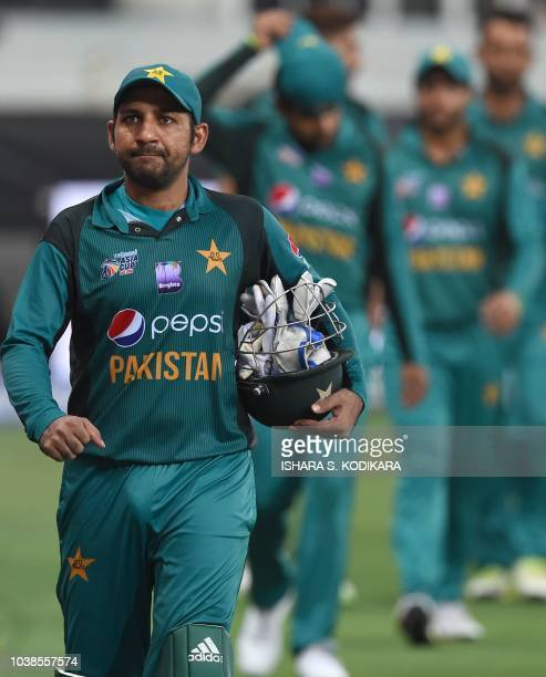 Pakistan's captain Sarfraz Ahmed leaves the field after India won by 9 wickets during the one day international Asia Cup cricket match between...