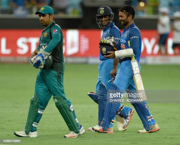 Pakistan's captain Sarfraz Ahmed leaves the field followed by India's Dinesh Karthik and Ambati Rayudu at the end of the one day international Asia...