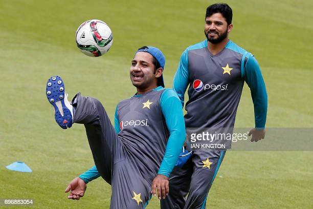 Pakistan's captain Sarfraz Ahmed plays football during a nets practice session at The Oval in London on June 17 on the eve of the ICC Champions...