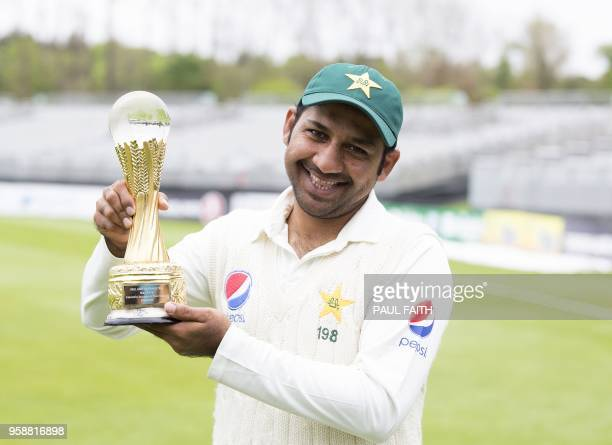 Pakistan's captain Sarfraz Ahmed poses with the trophy after beating Ireland on the final day of Ireland's inaugural test match against Pakistan at...