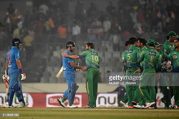 Pakistan's captain Shahid Afridi congratulates India's captain Mahendra Singh Dhoni at the end of the Asia Cup T20 cricket tournament match between...