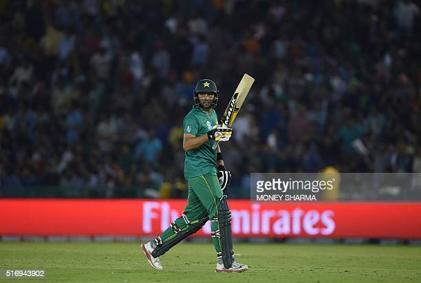 Pakistan's captain Shahid Afridi leaves the ground after getting dismissed during the World T20 cricket match between New Zealand and Pakistan at the...