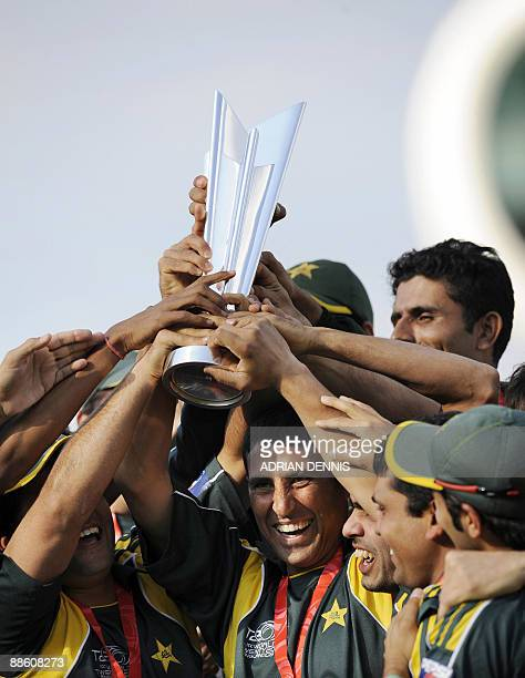 Pakistan's captain Younus Khan holds the trophy aloft with his teammates after defeating Sri Lanka in the final of the ICC Twenty20 Cricket World Cup...