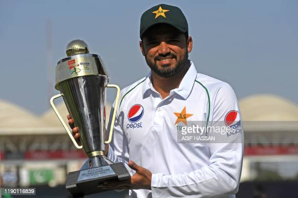Pakistan's cricket captain Azhar Ali holds trophy after winning the second Test cricket match between Pakistan and Sri Lanka at the National Cricket...
