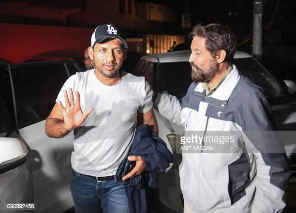 Pakistan's cricket captain Sarfraz Ahmed gestures as he arrives at home in Karachi on January 29 on his return from South Africa Pakistan cricket...