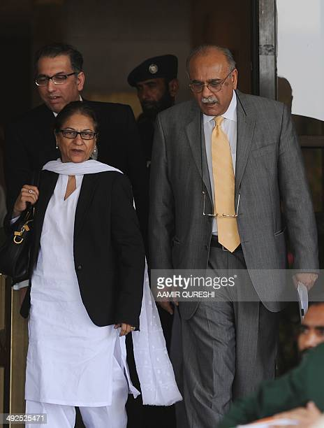 Pakistan's cricket chief Najam Sethi leaves the Supreme Court with his lawyer Asma Jehangir in Islamabad on May 21 2014 The Pakistani Supreme Court...