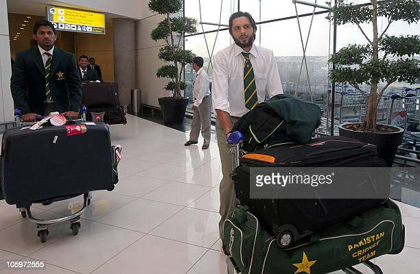 Pakistan's cricket team captain Shahid Afridi arrives with teammates at Abu Dhabi airport on October 23 2010 Pakistan will play two Twenty20 five...