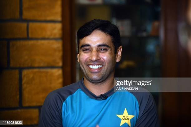 Pakistan's cricketer Abid Ali speaks during an open media session in Karachi on December 16 2019 ahead of the second cricket Test match between...