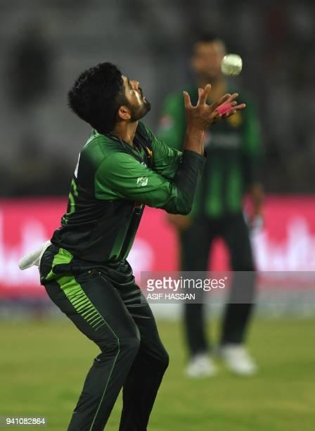 Pakistan's cricketer Babar Azam takes a catch of West Indies' batsman Rovman Powell during the second Twenty20 International cricket match between...