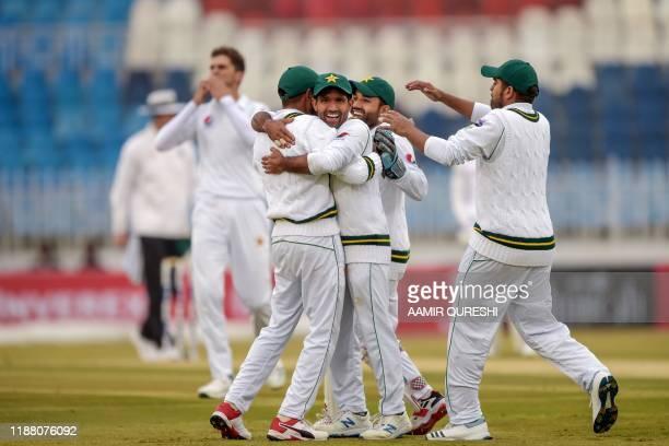 Pakistan's cricketers Asad Shafiq Babar Azam Mohammad Rizwan and Haris Sohail celebrate after the dismissal of Sri Lanka's Niroshan Dickwella during...