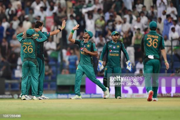 Pakistan's cricketers celebrate after Afghanistan team captain and batsman Mohammad Asghar is dismissed during the one day international Asia Cup...