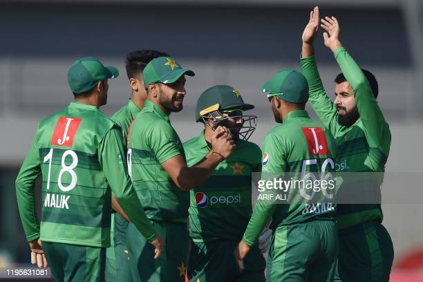 Pakistan's cricketers celebrate after the dismissal of Bangladesh's Tamim Iqbal unseen during the first T20 international cricket match of a...