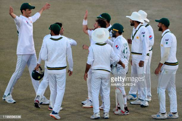Pakistan's cricketers celebrate after the dismissal of Bangladesh's Mohammad Mithun during the third day of the first cricket Test match between...