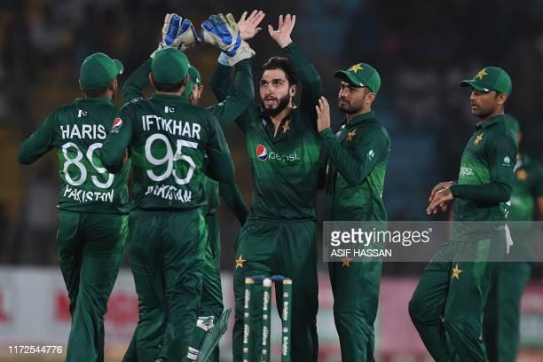 Pakistan's cricketers celebrate after the dismissal of Sri Lanka's batsman Avishka Fernando during the second one day international cricket match...