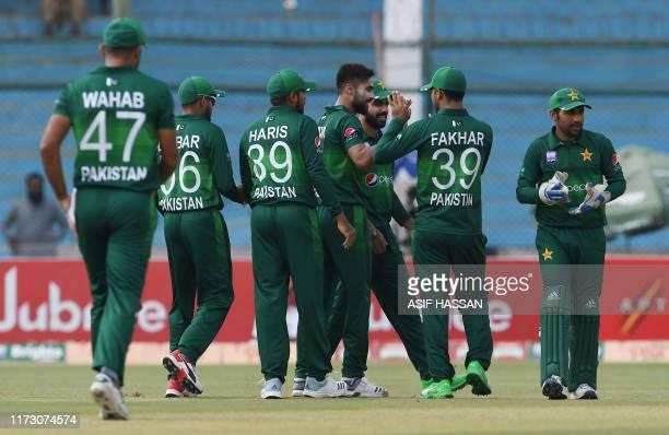 Pakistan's cricketers celebrate after the dismissal of Sri Lanka's batsman Avishka Fernando during the third and last one day international cricket...