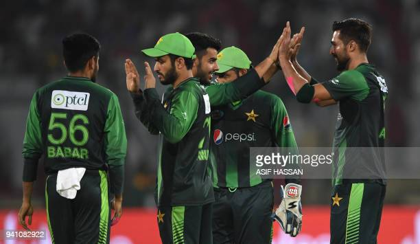 Pakistans' cricketers celebrate after the dismissal of West Indies' batsman Rovman Powell during the second Twenty20 International cricket match...