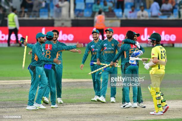 Pakistan's cricketers celebrate at the end of the third T20 cricket match between Pakistan and Australia at The International Cricket Stadium in...