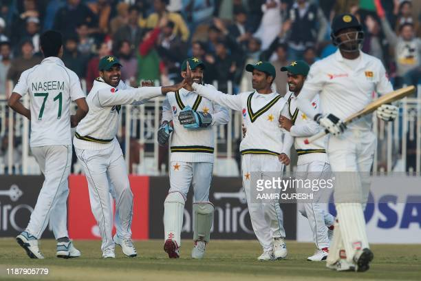 Pakistan's cricketers celebrate the dismissal of Sri Lanka's Angelo Mathews during the first day of the first Test cricket match between Pakistan and...