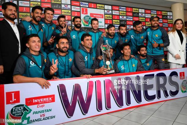 Pakistan's cricketers pose for a photograph with a winning trophy on the third and final Twenty20 International cricket match between Pakistan and...