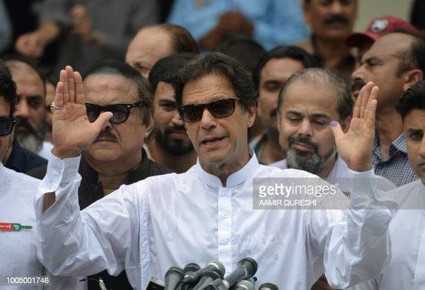 TOPSHOT Pakistan's cricketerturned politician Imran Khan of the Pakistan TehreekeInsaf speaks to the media after casting his vote at a polling...