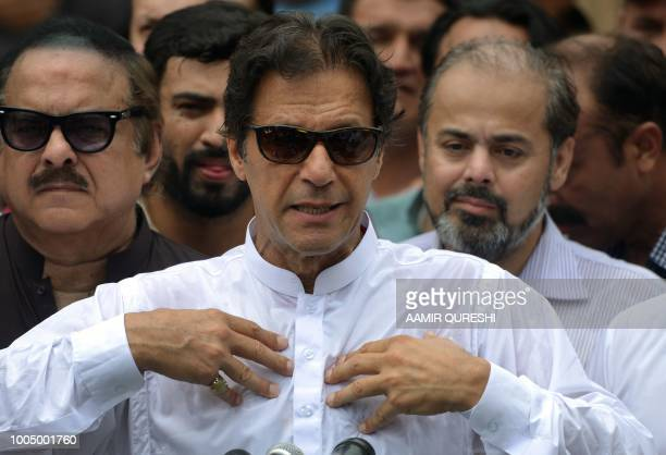 Pakistan's cricketerturned politician Imran Khan of the Pakistan TehreekeInsaf speaks to the media after casting his vote at a polling station during...