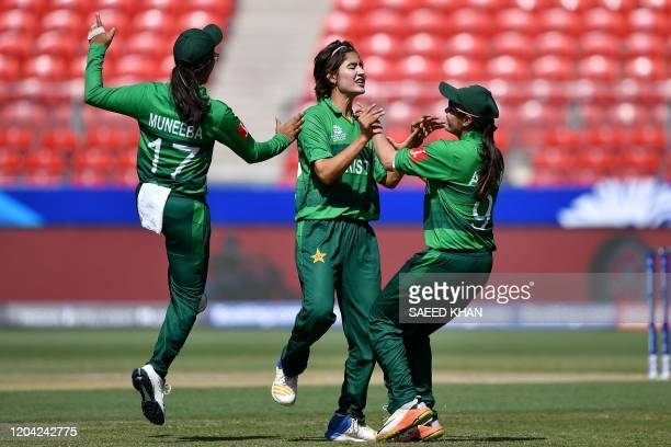 Pakistan's Diana Baig celebrates with teammates after taking the wicket of South Africa's batsman Lizelle Lee during the Twenty20 women's World Cup...