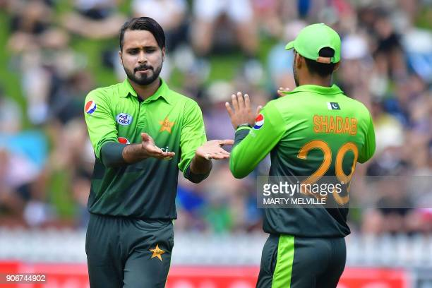 Pakistan's Faheem Ashraf celebrates bowling New Zealand's Ross Taylor with teammate Shadab Khan during the 5th oneday international cricket match...