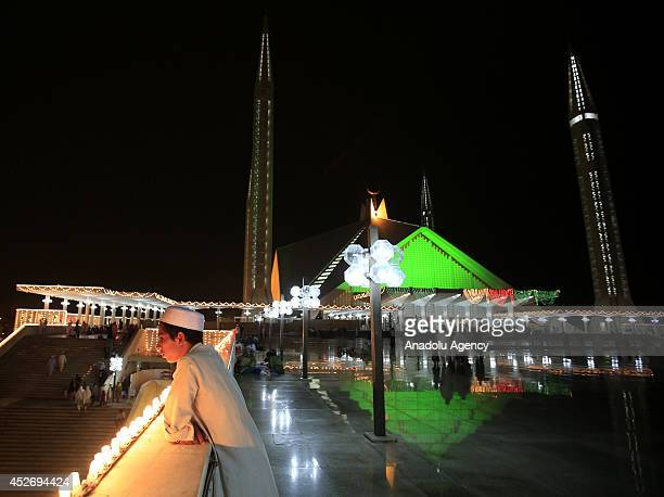 Pakistan's Faisal Mosque is decorated for Laylat AlQadr in Islamabad on July 25 2014 Pakistan has started to live Ramadan Month two days after many...