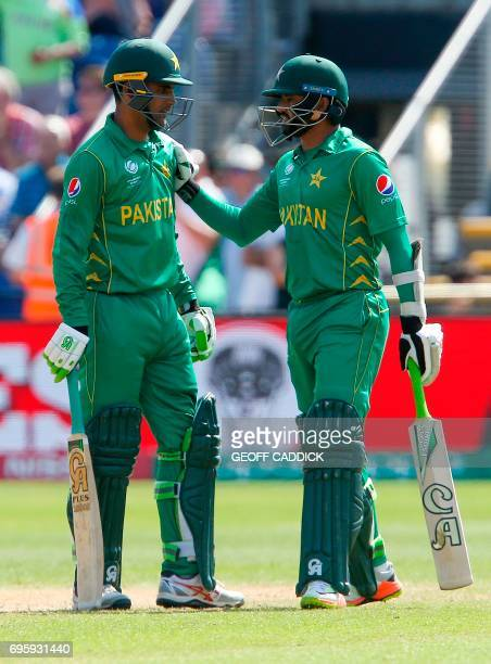 Pakistan's Fakhar Zaman and Pakistan's Azhar Ali react during the ICC Champions Trophy semifinal cricket match between England and Pakistan in...
