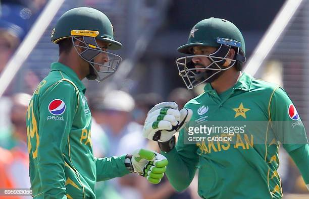 Pakistan's Fakhar Zaman and Pakistan's Azhar Ali touch gloves during the ICC Champions Trophy semifinal cricket match between England and Pakistan in...
