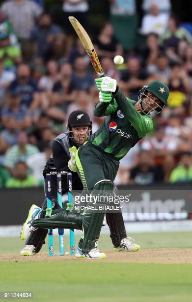 Pakistan's Fakhar Zaman bats watched by New Zealand's Tom Blundell during the third Twenty20 international cricket match between New Zealand and...