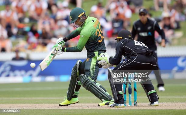 Pakistan's Fakhar Zaman bats watched by New Zealand's Tom Latham during the fourth oneday international cricket match between New Zealand and...