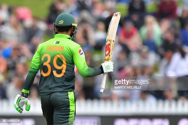 Pakistan's Fakhar Zaman celebrates 50 runs during the first one day international cricket match between New Zealand and Pakistan at Basin Reserve in...