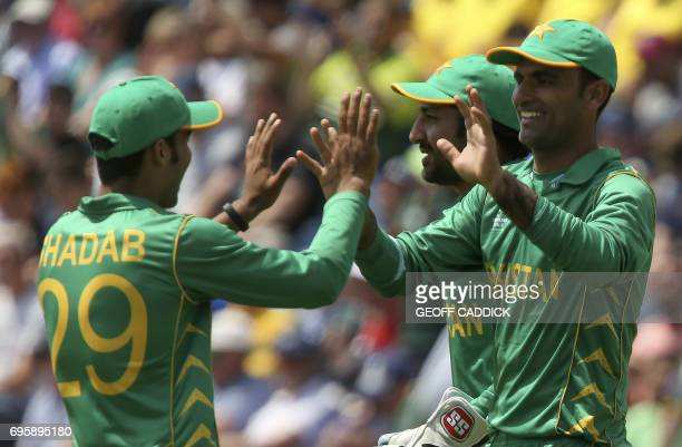 Pakistan's Fakhar Zaman celebrates with Pakistan's Shadab Khan the wicket of England's Moeen Ali during the ICC Champions Trophy semifinal cricket...