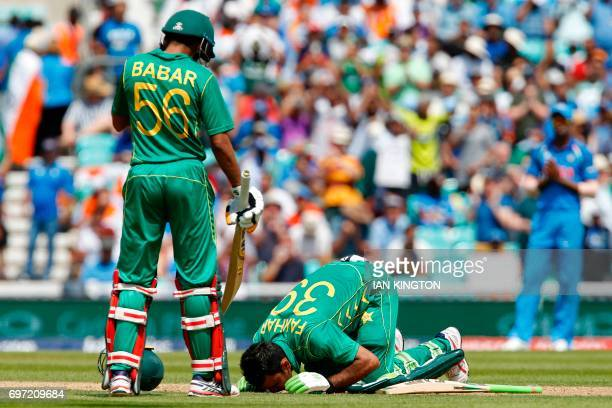 TOPSHOT Pakistan's Fakhar Zaman falls to his knees and kisses the grass as he celebrates reaching his 100 during the ICC Champions Trophy final...